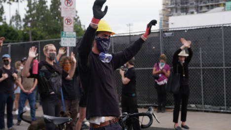 Hollywood-Injured-Man-Holding-Hands-Up-During-Protest