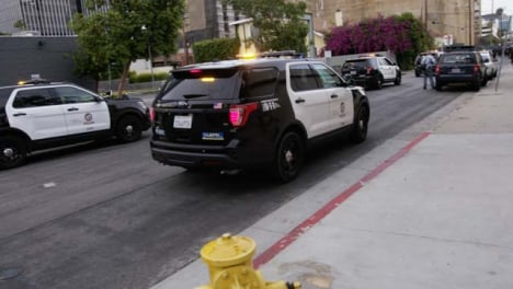 Hollywood-Police-Vehicles-Slowly-Moving-on-Street