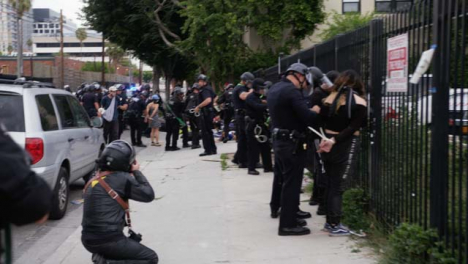 Hollywood-Protesters-Arrested-and-Zip-Tied-against-Fence