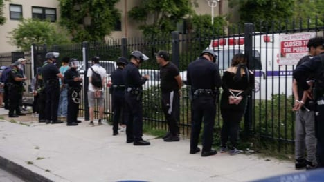 Hollywood-Protesters-Arrested-by-Police-and-Zip-Tied-against-Fence