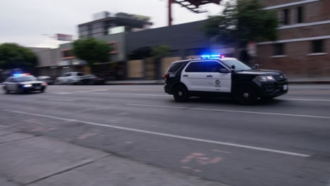 Hollywood-Pan-Convoy-of-US-Police-Cars-Driving-Past