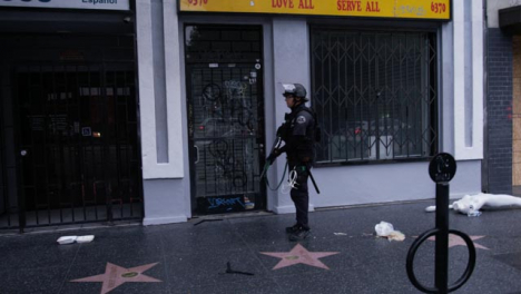 Hollywood-Armed-Police-Officer-Ordering-People-To-Move