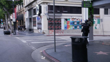 Hollywood-Armed-Police-Officer-Pointing-Gun-and-Ordering-People-To-Move