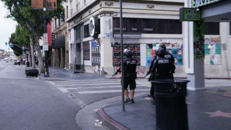 Hollywood-Group-of-Police-Officers-Walk-Empty-Street-in-LA