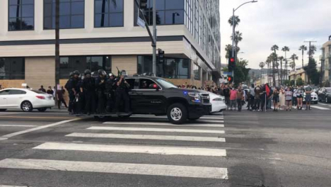 Hollywood-Convoy-of-Police-Vehicles-Carrying-Officers-Driving-Past