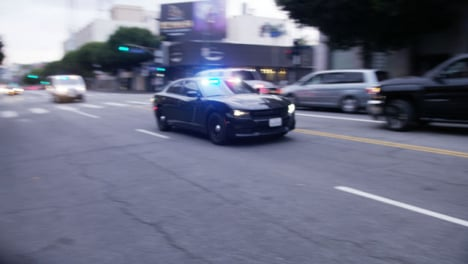 Hollywood-Police-Vehicles-with-Flashing-Siren-Driving-Past