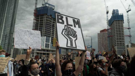 BLM-London-Protestor-Holds-Up-Power-Fist-Sign-in-Chanting-Crowd