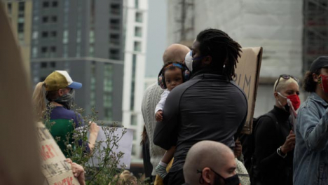 BLM-London-Protestor-Holds-Infant-Amongst-Clapping-Crowd