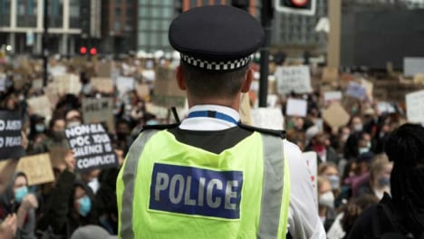 London-Police-Officer-Monitors-Large-Crowd-of-BLM-Protestors