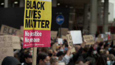 A-BLM-Sign-Being-Marched-Through-London-Crowd-of-Protestors