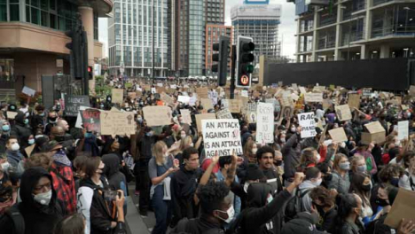Large-Gathering-of-BLM-Protestors-Hold-Signs-in-London-Streets