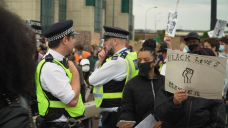 London-Protesters-Walk-Past-Police-During-March