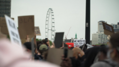 London-Crowd-of-Protesters-March-With-London-Eye-in-Distance