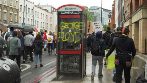 London-Protest-Graffiti-Written-Phone-Box