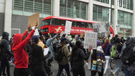 London-Anti-Racism-Protesters-Marching-past-Bus