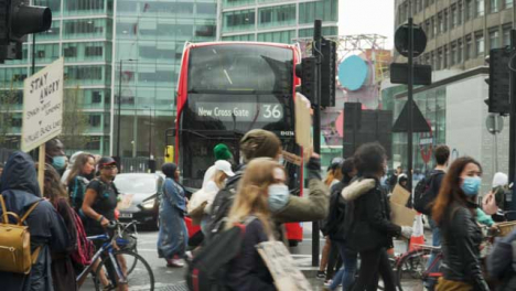 London-Anti-Racism-Protesters-Walking-by-Bus