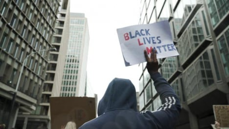 London-Protester-Holding-Black-Lives-Matter-Sign