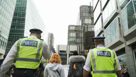 London-Police-Officers-Walking-With-Protesters