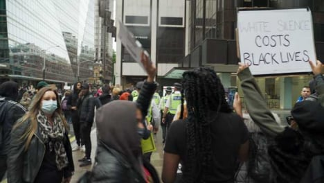 London-Police-Officers-Walking-Amongst-Protesters