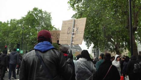 London-Black-Lives-Matter-Protester-Marches-Holding-Anti-Racism-Sign
