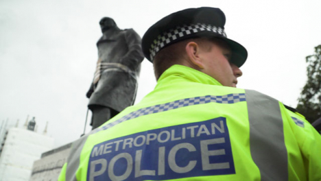 London-Police-Officer-Next-to-Graffitied-Churchill-Statue-During-Protest