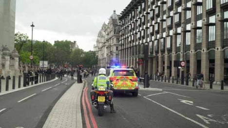 London-Police-Motorbike-and-Car-in-front-of-Crowd-of-Protesters