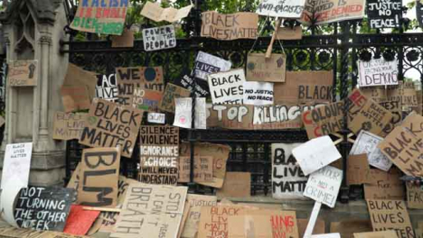 London-Tracking-out-to-Wall-of-Black-Lives-Matter-Signs-