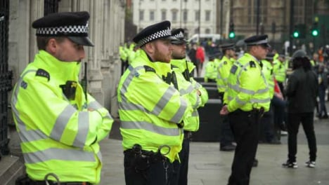 London-Line-of-Police-Officers-on-Street-During-Protests