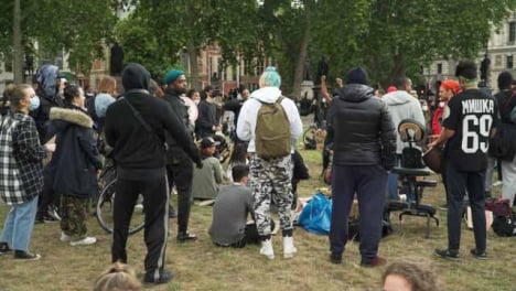 London-Group-of-Activists-Dancing-to-Music-in-Park