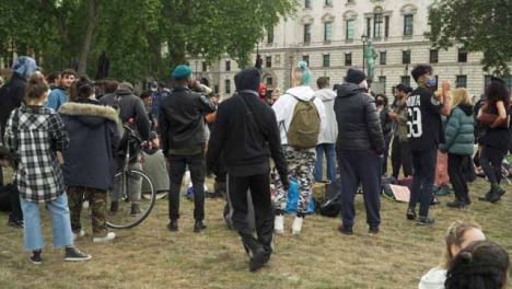 London-Male-Activist-Dancing-to-Música-in-Park