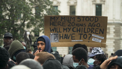 London-Black-Lives-Matter-Sign-Held-Above-Crowd