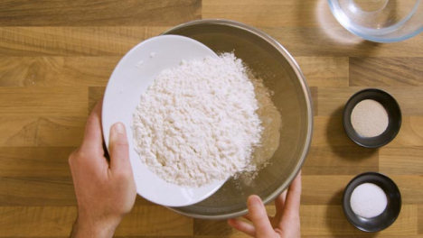 Top-View-Pouring-Flour-in-Bowl