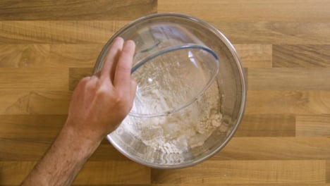 Top-View-Pouring-Water-into-Bowl