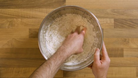 Top-View-Mixing-Ingredients-Into-a-Dough