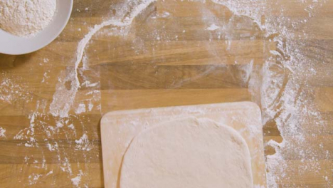 Top-View-Pizza-Dough-on-Pizza-Peel