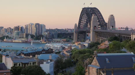 Sydney-Bridge-and-Harbour-Over-the-Rocks-at-Sunset
