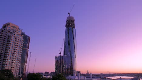 Tall-Skyscraper-Under-Construction-at-Sunset
