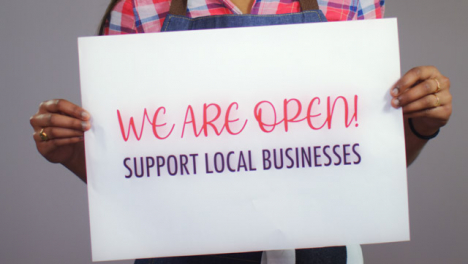 Close-Up-of-Woman-Holding-Support-Local-Business-Sign