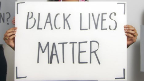 Close-Up-of-Woman-Holding-Black-Lives-Matter-Sign