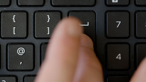 Top-View-Finger-Pushing-Enter-Keyboard-Button