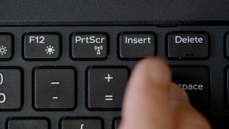 Top-View-Finger-Pushing-Backspace-Keyboard-Button