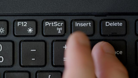 Top-View-Finger-Pressing-Backspace-Keyboard-Button