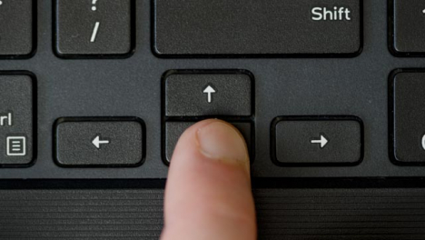 Top-View-Finger-Pressing-Arrow-Keyboard-Buttons