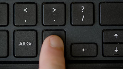 Top-View-Finger-Pressing-Ctrl-Keyboard-Button