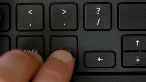 Top-View-Finger-Pushing-Alt-Gr-and-Ctrl-Keyboard-Buttons