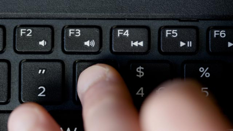 Top-View-Finger-Pressing-Number-Buttons-Keyboard