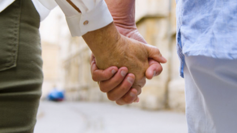 Extreme-Close-Up-of-Middle-Aged-Couple-Holding-Hands