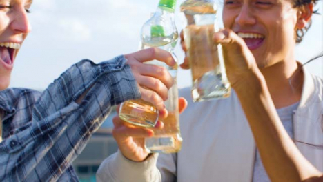 Close-Up-of-3-Friends-Enjoying-a-Drink-On-Rooftop