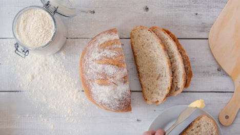 Top-View-Hand-Picking-Up-Slice-of-Bread