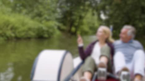 Blurred-Couple-in-Pedal-Boat-on-River